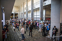 Inside view as thousands of SXSW attendees walk the halls of the Austin Convention Center, home of conference panels and keynotes, and trade shows.