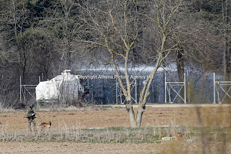 Pictured: A water canon fires water. Sunday 01 March 2020<br /> Re: Clashes between migrants and riot police at the Greek-Turkish border of Kastanies near Evros, Greece