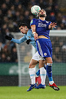 Manchester City's Brahim Diaz competing in the air with Leicester City's Vicente Iborra<br /> <br /> Photographer Andrew Kearns/CameraSport<br /> <br /> English League Cup - Carabao Cup Quarter Final - Leicester City v Manchester City - Tuesday 18th December 2018 - King Power Stadium - Leicester<br />  <br /> World Copyright © 2018 CameraSport. All rights reserved. 43 Linden Ave. Countesthorpe. Leicester. England. LE8 5PG - Tel: +44 (0) 116 277 4147 - admin@camerasport.com - www.camerasport.com