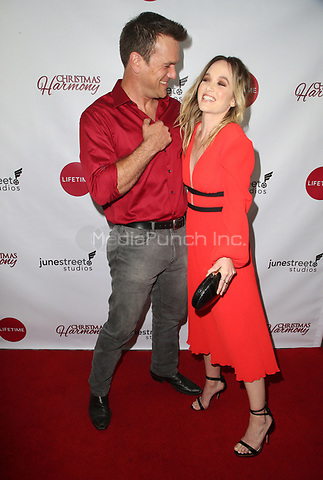 "LOS ANGELES, CA - NOVEMBER 7: Adam Mayfield, Kelley Jakle, at Premiere of Lifetime's ""Christmas Harmony"" at Harmony Gold Theatre in Los Angeles, California on November 7, 2018. Credit: Faye Sadou/MediaPunch"
