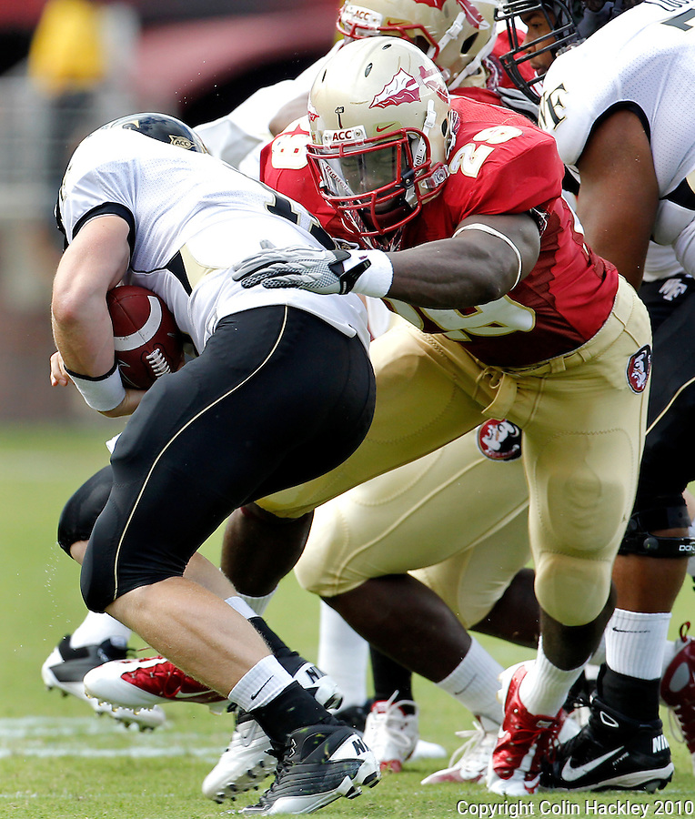 TALLAHASSEE, FL 9/25/10-FSU-WF FB10 CH-Florida State's Kendall Smith tackles Wake Forest's Tanner Price  during first half action Saturday at Doak Campbell Stadium in Tallahassee. .COLIN HACKLEY PHOTO