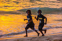 Kanak children playing on the beach, Chateaubriand Bay, Lifou (island), Loyalty Islands, New Caledonia
