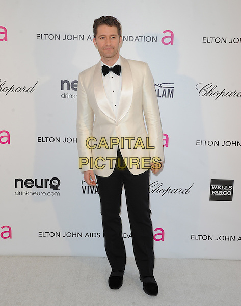 Matthew Morrison.The 21st Annual Elton John AIDS Foundation Academy Awards Viewing Party held at The City of West Hollywood Park in West Hollywood, California, USA..February 24th, 2013.oscars full length white tuxedo jacket black trousers                               .CAP/DVS.©DVS/Capital Pictures.