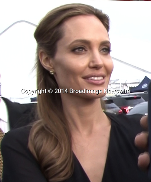 Pictured: Brad Pitt and Angelina Jolie<br /> Mandatory Credit &copy; Fernando Allende/Adriano Camolese/Broadimage<br /> Angelina Jolie gives spanks Brad's Pitt butt as they sign autographs in Santa Monica<br /> <br /> 3/1/14, Santa Monica, California, United States of America<br /> Reference: 030114_FALA_BDG_052<br /> <br /> Broadimage Newswire<br /> Los Angeles 1+  (310) 301-1027<br /> New York      1+  (646) 827-9134<br /> sales@broadimage.com<br /> http://www.broadimage.com