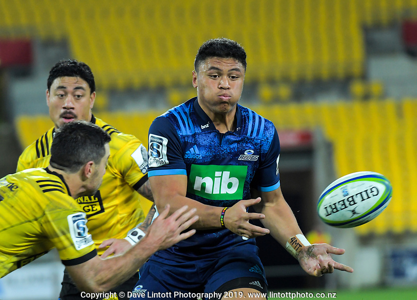 Caleb Clarke passes during the Super Rugby match between the Hurricanes and Blues at Westpac Stadium in Wellington, New Zealand on Saturday, 15 June 2019. Photo: Dave Lintott / lintottphoto.co.nz