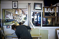 A TROSA resident prepares an order at the TROSA frame shop in downtown Durham.