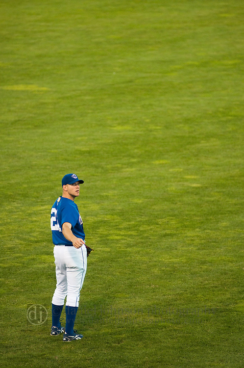 June 29, 2009 -- Omaha Royals left fielder Scott Thorman, from Cambridge, Ontario, looks at the scoreboard between pitches against the Albuquerque Isotopes in a minor league professional baseball game on Monday June 29, 2009 in Omaha, Nebraska. PHOTO/Daniel Johnson
