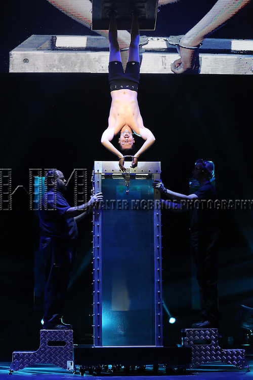 Andrew Basso performing in a press preview of 'The Illusionists' at Mariott Marquis Theatre on December 2, 2014 in New York City.