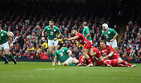 Pictured: Rhys Webb of Wales passes the ball Saturday 14 March 2015<br />
