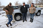 Lovelock, Nev. residents, from left, Chris Montes, Salvador Paredes and Lucia Gonzalez talk about helping to find a group of six people who were stranded for two days in the frigid mountains, east of Reno, Nev., on Tuesday, Dec. 10, 2013. (AP Photo/Cathleen Allison)