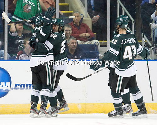 Matt Berry (MSU - 27), Lee Reimer (MSU - 22), Jake Chelios (MSU - 42) - The Union College Dutchmen defeated the Michigan State University Spartans 3-1 in their NCAA East Regional semifinal on Friday, March 23, 2012, at the Webster Bank Arena in Bridgeport, Connecticut.
