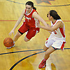 Emily Meyer #12 of St. John the Baptist, left, gets pressured by Taylor Aybar #23 of Monsignor McClancy during the CHSAA varsity girls basketball Class B state semifinals at Monsignor McClancy High School in East Elmhurst, NY on Friday, Mar. 11, 2016. McClancy won by a score of 63-49.