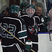 Brad Bogus, Lake Orion, celebrates scoring a goal with teammate Nick Balavich (23) during hockey action against Farmington Thursday, Dec. 1, 2011.