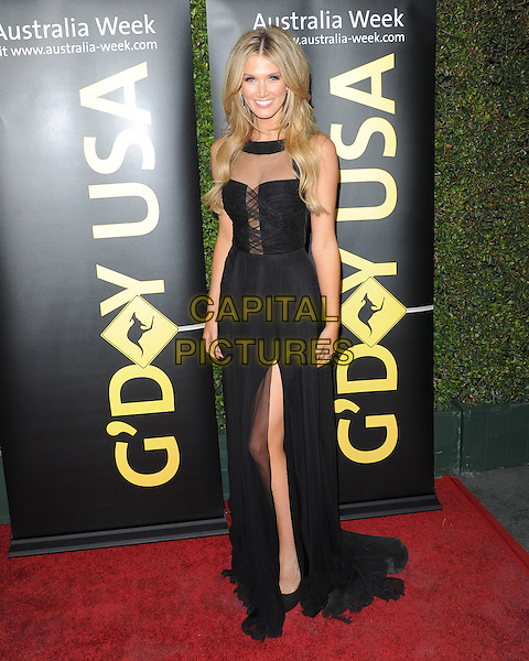 Delta Goodrem.The G'Day USA Australia Week 2012 Black Tie Gala at Hollywood & Highland Grand Ballroom in Hollywood, California, USA..January 14th, 2011.full length black dress slit split sheer  .CAP/RKE/DVS.©DVS/RockinExposures/Capital Pictures.