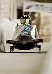 8 January 2016: Codie Bascue, piloting his 2-man bobsled for the United States of America, enters the Chicane straightaway on his first run, ending the day with a combined 2-run time of 1:51.49 and earning an 11th place finish at the BMW IBSF World Cup Championships at the Olympic Sports Track in Lake Placid, New York, USA. Mandatory Credit: Ed Wolfstein Photo *** RAW (NEF) Image File Available ***