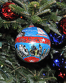 "Washington, DC - December 3, 2008 -- Close-up of one of the 369 hand-colored ornaments on the White House Christmas Tree in the Blue Room of the White House during a media preview of the 2008 holiday decorations and tasting event in Washington, D.C. on Wednesday, December 3, 2008.  This ornament is from New York. Each ornament was commissioned by individual members of Congress to ""characterize the unique, patriotic spirit of the artist's state, district or territory. Every member of the United States House and Senate were invited by Mrs. Bush to participate.  The theme of this years decorations is ""a Red, White, and Blue Christmas""..Credit: Ron Sachs / CNP"