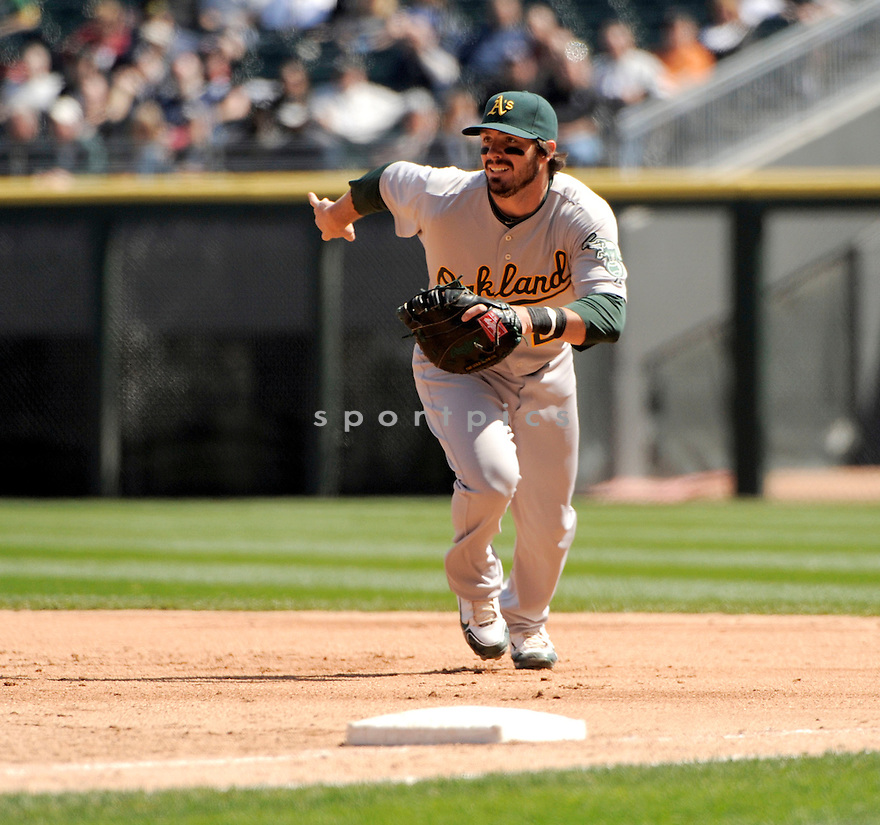 ANDY LAROCHE, of the Oakland A's, in action during the A's game against the Chicago White Sox on April 13, 2011 at US Cellular Field in Chicago, Illinois.  The Oakland A's beat the Chicago White Sox 7-4.