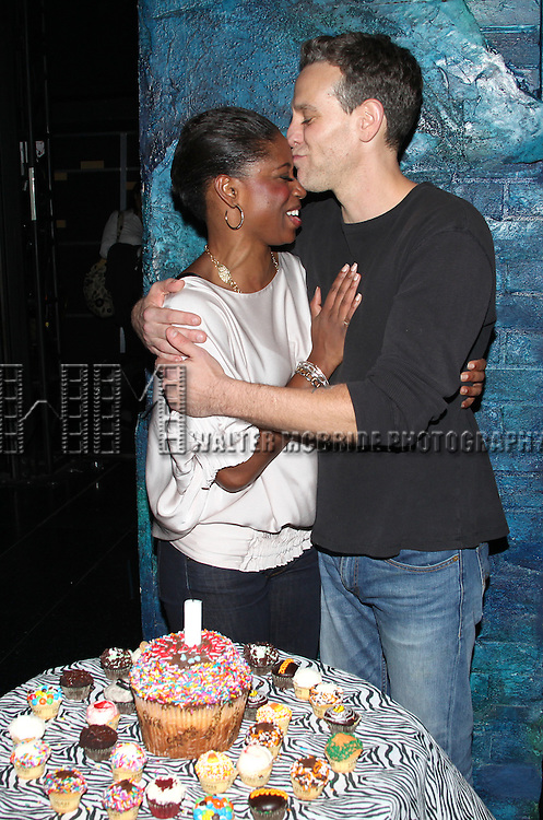 Adam Pascal with Montego Glover celebrating his Birthday backstage after his first performance  in 'Memphis'  at the Shubert Theatre in New York City.
