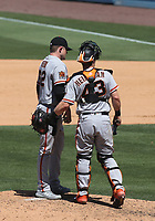 25th July 2020, Los Angeles, California, USA;  San Francisco Giants pitcher Logan Webb (62) talks with San Francisco Giant catcher Tyler Heineman (81) during the game against the Los Angeles Dodgers on July 25, 2020, at Dodger Stadium in Los Angeles, CA.