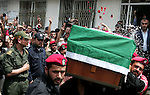 Palestinian Hamas security personnel carry the coffin of the pro-Palestinian Italian activist Vittorio Arrigoni during his funeral in Gaza City, Gaza Strip, 18 April 2011. After the funeral, the body of Vittorio Arrigoni was transported through the Rafah border crossing to Egypt and then to Italy. Reports state that Hamas, the group which rules the Gaza Strip, discovered the body of the pro-Palestinian Italian activist on 15 April, who was allegedly killed by a group known as the Salafists. Photo by Mohammed Othman