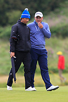 James Sugrue (IRL)(AM) walks up the 12th fairway with Neill Manchip during the preview of the the 148th Open Championship, Portrush golf club, Portrush, Antrim, Northern Ireland. 17/07/2019.<br /> Picture Thos Caffrey / Golffile.ie<br /> <br /> All photo usage must carry mandatory copyright credit (© Golffile | Thos Caffrey)