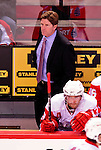 21 November 2009: Detroit Red Wings Head Coach Mike Babcock, entering his fifth season at the helm of the Wings, looks out from behind the bench during a game against the Montreal Canadiens at the Bell Centre in Montreal, Quebec, Canada. The Canadiens, wearing their original 1909-10 throwback jerseys, dropped the game to the Red Wings in a shootout 3-2 in their Original Six matchup. Mandatory Credit: Ed Wolfstein Photo