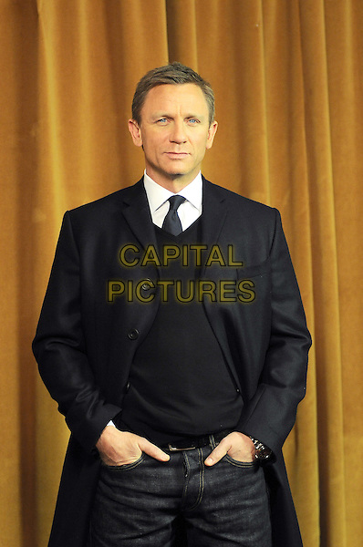 "DANIEL CRAIG .Photocall for ""Defiance"", Rome, Italy..January 19th, 2009.half length black blue jacket sweater jumper hands in pockets .CAP/CAV.©Luca Cavallari/Capital Pictures."