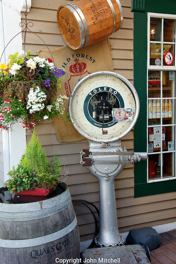 Vintage Toledo weighing scale being used as a decoration outside a store in the village of Steveston, British Columbia, Canada