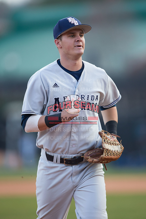 Florida Atlantic Owls right fielder Brendon Sanger (23) jogs off the field between innings of the game against the Charlotte 49ers at Hayes Stadium on March 14, 2015 in Charlotte, North Carolina.  The Owls defeated the 49ers 8-3 in game one of a double header.  (Brian Westerholt/Four Seam Images)