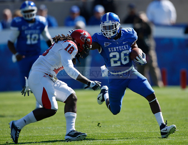 UK running back CoShik Williams stiff arms Jacksonville State defensive back Robert Gray for a first down during the first half of UK's home game against Jacksonville State in Commonwealth Stadium in Lexington, Ky. Oct. 22, 2011. Photo by Brandon Goodwin   Staff
