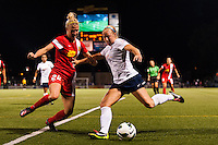 Sky Blue FC defender Kendall Johnson (5) is marked by Western New York Flash defender Amy Barczuk (22) during a National Women's Soccer League (NWSL) semifinal match at Sahlen's Stadium in Rochester, NY, on August 24, 2013.