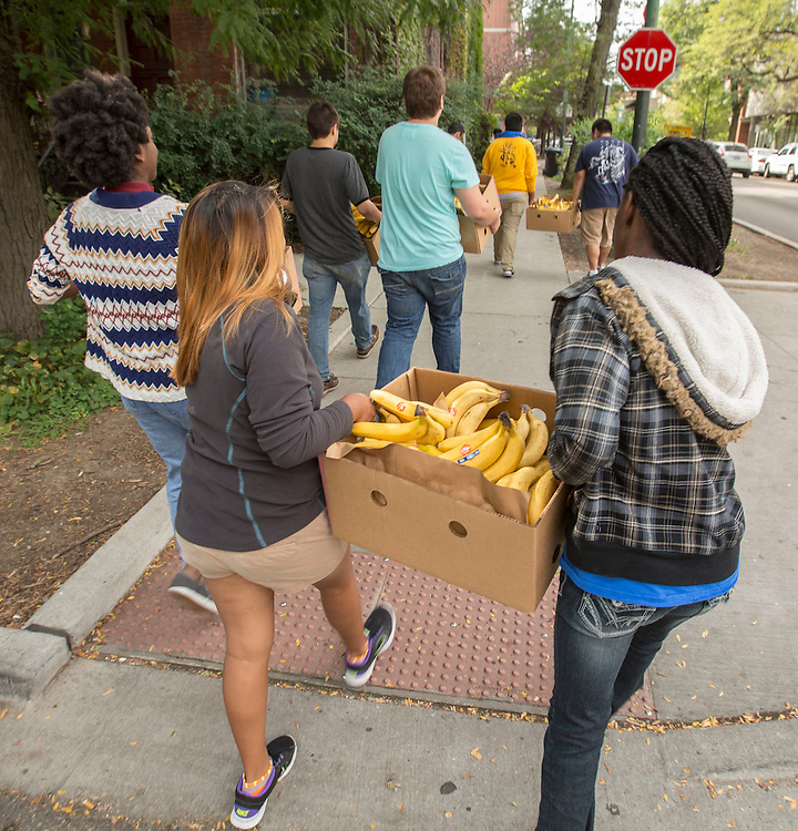 DePaul University students deliver crates of bananas to the St. Vincent de Paul Church in Lincoln Park Tuesday, Sept. 9, 2014. The student volunteers were participating in the annual New Student Service Day across the city of Chicago. The Lincoln Park church operates the Mother Seton Food Pantry and Sandwich Window which provides food for the hungry. (DePaul University/Jamie Moncrief)