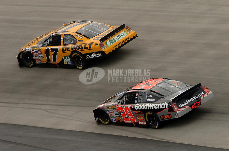 Sept. 24, 2006; Dover, DE, USA; Nascar Nextel Cup driver Matt Kenseth (17) leads Kevin Harvick (29) during the Dover 400 at Dover International Speedway. Mandatory Credit: Mark J. Rebilas