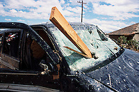 A destroyed van is left impaled by a board from a house after a devastating killer F-5 tornado struck Moore Oklahoma on May 3rd, 1999.