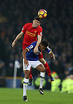 James Milner of Liverpool and Dominic Calvert-Lewin of Everton during the English Premier League match at Goodison Park, Liverpool. Picture date: December 19th, 2016. Photo credit should read: Lynne Cameron/Sportimage