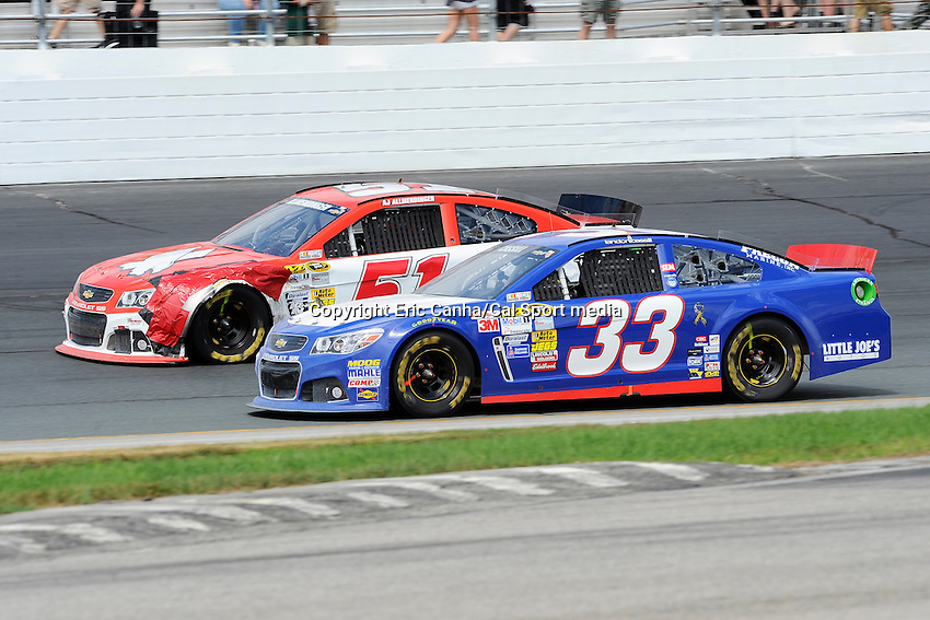 July 14, 2013 - Loudon, New Hampshire U.S. - Sprint Cup Series driver Landon Cassill (33) and AJ Allmendinger (51) fight for position during the NASCAR Sprint Cup Series Camping World RV Sales 301 held at the New Hampshire Motor Speedway in Loudon, New Hampshire.   Eric Canha/CSM