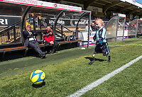 Accrington Stanley Manager John Coleman looks on as a young disabled Wycombe Wanderers mascot goes through his routine before the Sky Bet League 2 match between Wycombe Wanderers and Accrington Stanley at Adams Park, High Wycombe, England on the 30th April 2016. Photo by Liam McAvoy / PRiME Media Images.