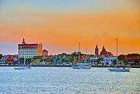 The historic bay front downtown St. Augustine, Florida. This image is taken from a boat in the Matanzas River looking toward a golden sunset in St. Augustine, Florida.