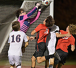 Springfield goalkeeper Collin Taylor punches the ball away in a flurry of activity in front of the gaol. Also shown are Gibault players Cameron Kincheloe (left) and Logan Doerr (partially hidden). Springfield players are Alfred Hofmann (18) and Jacks Hyde (23). Gibault High School defeated Springfield HS 2-0 in the Class 2A Soccer Sectional at Chatham on Tuesday October 30, 2018 and advance to the state tournament. <br /> Tim Vizer/Special to STLhighschoolsports.com