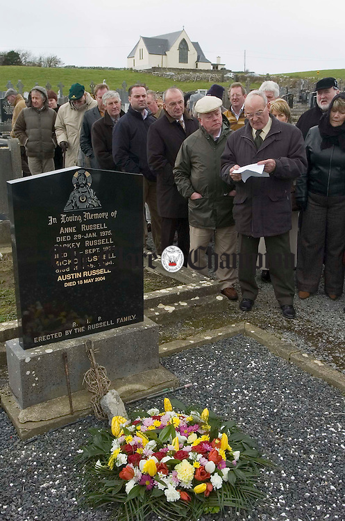 A poem is recited in honor of Micho Russell at his graveside during the Russell Memorial Weekend at Doolin. Photograph by John Kelly.