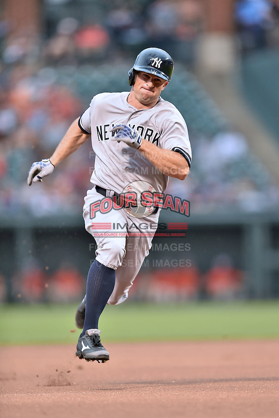 New York Yankees left fielder Brett Gardner #11 runs to third during a game against the Baltimore Orioles at Oriole Park at Camden Yards August 11, 2014 in Baltimore, Maryland. The Orioles defeated the Yankees 11-3. (Tony Farlow/Four Seam Images)