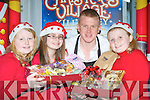 Niall O'Loughlin from Gandpa Charlie Auld Sweet Shop supplied the treats for l-r: Sarah Doody, Georgina Wharton,  and Aoife Doyle at the launch of the Christmas in Killarney campaign in the Malton Hotel on Saturday..