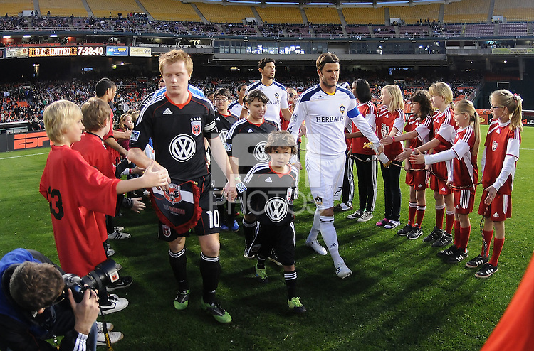DC United midfielder Dax McCarty (10) with Los Angeles Galaxy midfielder David Beckham getting into the field.    DC United tied  Los Angeles Galaxy 1-1, at RFK Stadium, Saturday April 9, 2011.