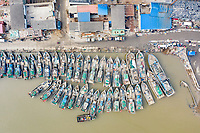 Fishing boats lined up in Nanbao village, Hebei Province. China, 2019.