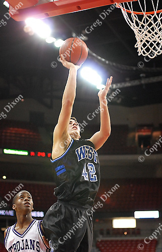 "6'5"" Junior for the Oshkosh West Wildcats, Austin Meier, helps last year's Wisconsin high school state champions to a 52-43 victory over the Milwaukee Bradley Tech Trojans Tuesday night, 12/26/06, at the Kohl Center in Madison"