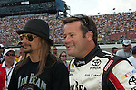June 14 2009:  Musician Kid Rock (left) and Sprint Cup driver Robby Gordon (right) on the grid at the LifeLock 400 at Michigan International Speedway in Brooklyn, MIchigan.