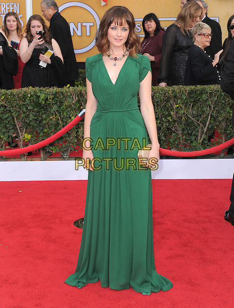 Alexis Bledel (wearing Rena Lange).Arrivals at the 19th Annual Screen Actors Guild Awards at the Shrine Auditorium in Los Angeles, California, USA..27th January 2013.SAG SAGs full length green dress clutch bag beige.CAP/DVS.©DVS/Capital Pictures.