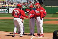 March 4, 2010:  Manager Charlie Manual of the Philadelphia Phillies greets Ben Francisco as Jimmy Rollins looks on during introductions before a Spring Training game at Bright House Field in Clearwater, FL.  Photo By Mike Janes/Four Seam Images