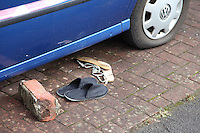 Pictured: Clothing items and slippers outside the house in the Alltwen area of Pontardawe, south Wales where a four year old boy died in a fire. Wednesday 27 July 2016<br /> Re: A four-year-old boy has died following a fire at a house in Neath Port Talbot.<br /> Fire crews were called to the property in Lon Tanyrallt, Alltwen, near Pontardawe, at 1.40am on Wednesday.<br /> They rescued the boy from an upstairs bedroom in the two-storey semi-detached house but he died at the scene.<br /> A three-year-old boy was also rescued and take to hospital along with his sister, six, and mother who had both managed to escape the blaze.<br /> They were all suffering from suspected smoke inhalation.<br /> Mid and West Wales Fire and Rescue Service said the woman, who is believed to be in her 20s, called for help and neighbours tried to get in to help the stranded children.