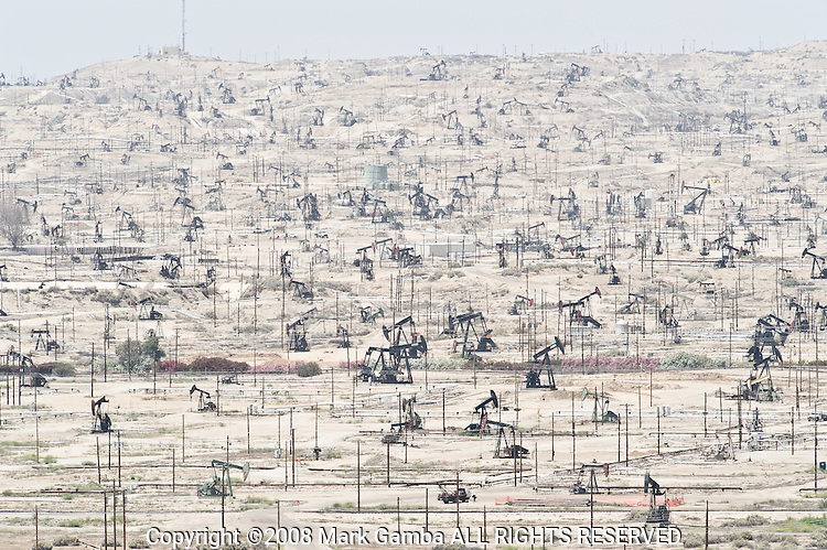 The Kern River Oil Field, discovered in 1899, covers an area of 10,750 acres  in a rough oval extending over the low hills north-northeast of Bakersfield, hills which are now almost completely barren except for oil rigs, drilling pads, and associated equipment. This area is the densest operational oil development in the state of California, yielding a cumulative production of close to 2 billion barrels of oil by the end of 2006, it is the third-largest oil field in California. The principal operator on the field was Chevron Corp.